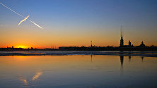 Sunset on the Neva Embankment. The Cathedral of Saints Peter and Paul and Fortress in the background
