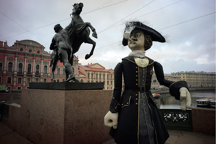 A giant figure of Peter the Great on a walk in St. Petersburg during White Nights on the eve of City Day